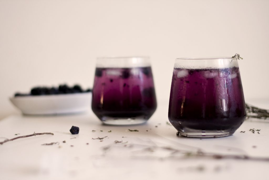 Blueberry and Lavender Gin and Tonic in cocktail glasses